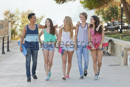 group of diverse teens on holiday  Stock photo © godfer