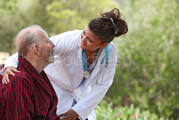 Stock photo: nurse and patient home care (focus on man)