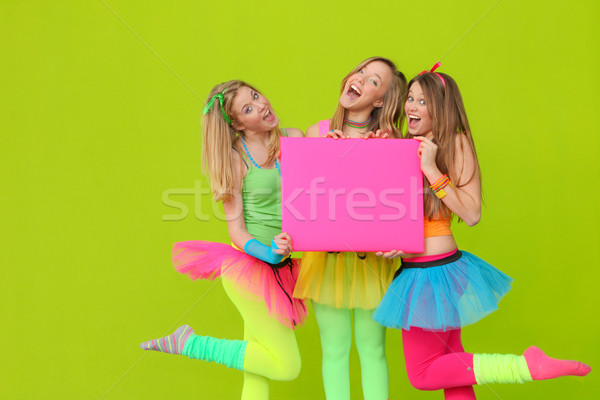 happy party or fancy dress girls with blank board Stock photo © godfer