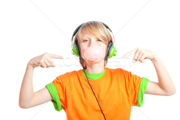 child blowing gum an listening to music  Stock photo © godfer