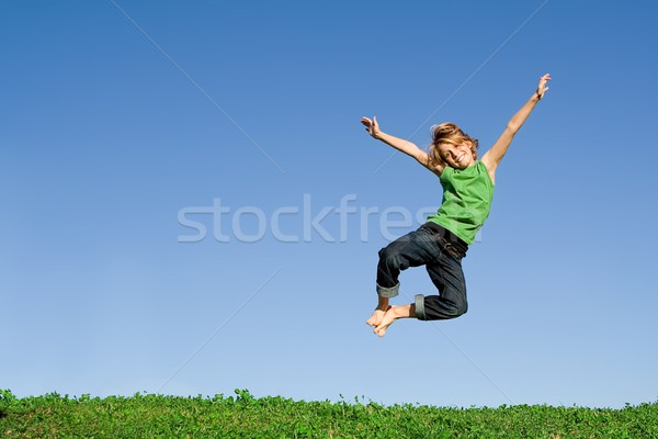 fit healthy active happy smiling child, jumping for joy Stock photo © godfer