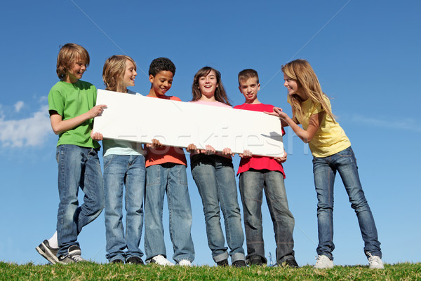 group of diverse children holding blank white poster Stock photo © godfer