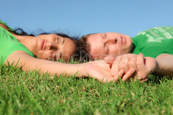 sleeping couple , focus on holding hands, Stock photo © godfer