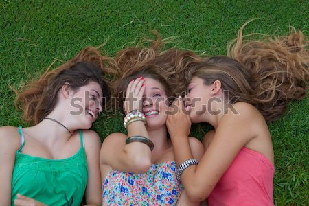 group of teens blowing kisses Stock photo © godfer