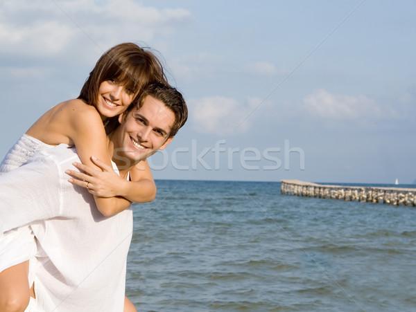 Gelukkig op de rug paar zomer huwelijksreis vakantie Stockfoto © godfer