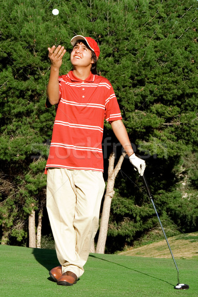 golf junior with ball and club Stock photo © godfer