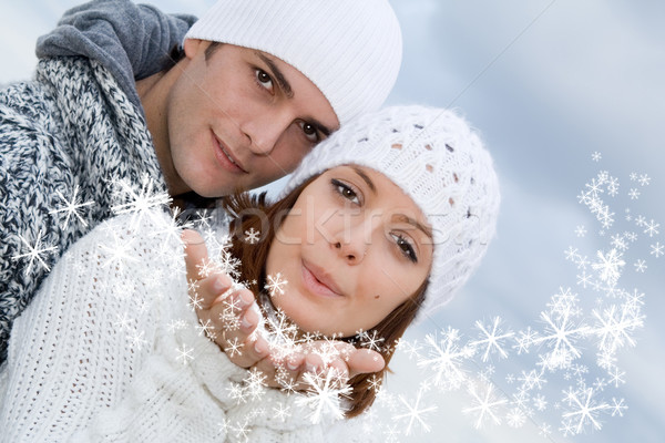 young couple blowing christmas or new years eve wishes Stock photo © godfer