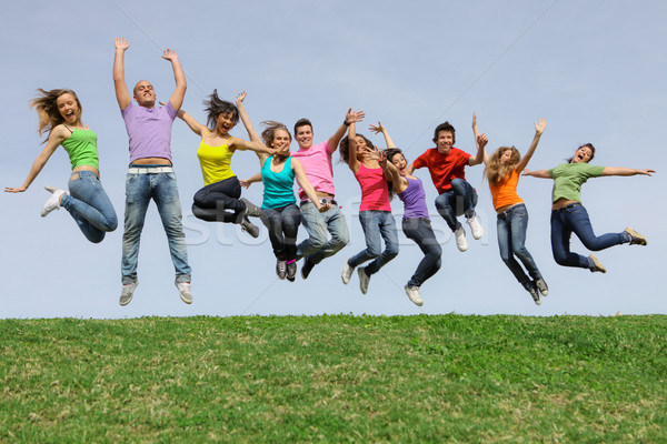 Happy smiling diverse mixed race group jumping Stock photo © godfer