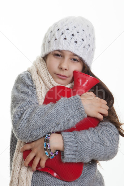 cold sick ill child with hot water bottle.  Stock photo © godfer