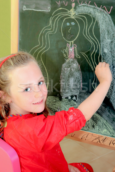 happy artistic,kid,drawing on blackboard in class or home Stock photo © godfer