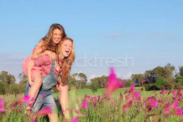 happy smiling spring or summer piggy back teens or teenagers Stock photo © godfer