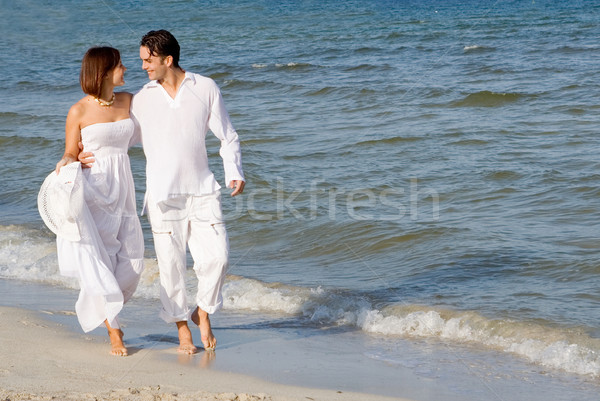 young honeymoon, couple walking on beach on summer holiday or vacation Stock photo © godfer