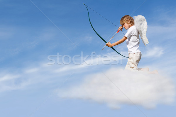 valentines day concept, cupid on cloud, shooting arrow Stock photo © godfer