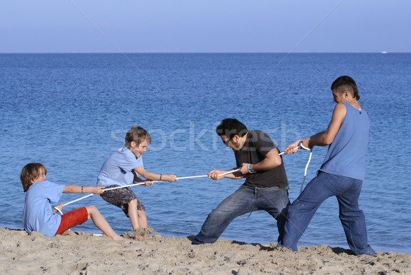 tug of war game, kids playing at beach with unfair advantage Stock photo © godfer