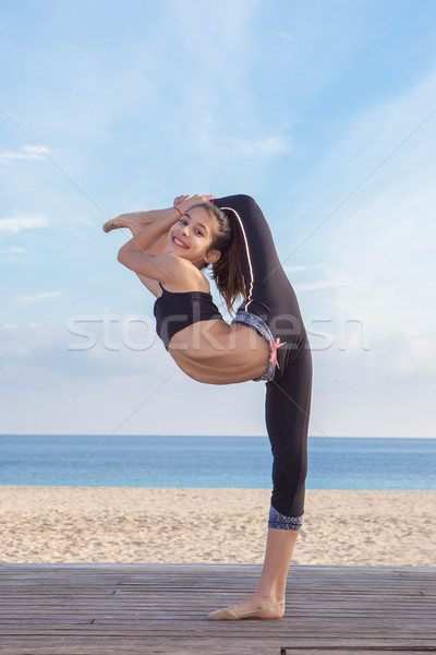 acrobatic flexible young girl dancer Stock photo © godfer