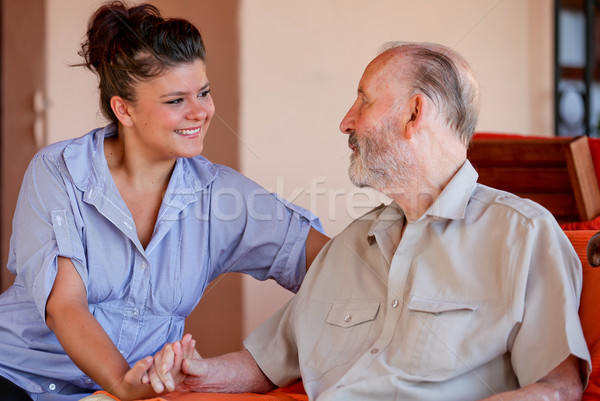elderly man with nurse carer or granddaughter. Stock photo © godfer