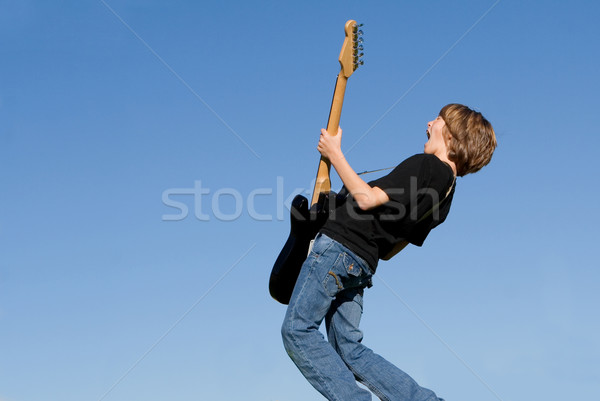 child musician playing guitar and singing Stock photo © godfer