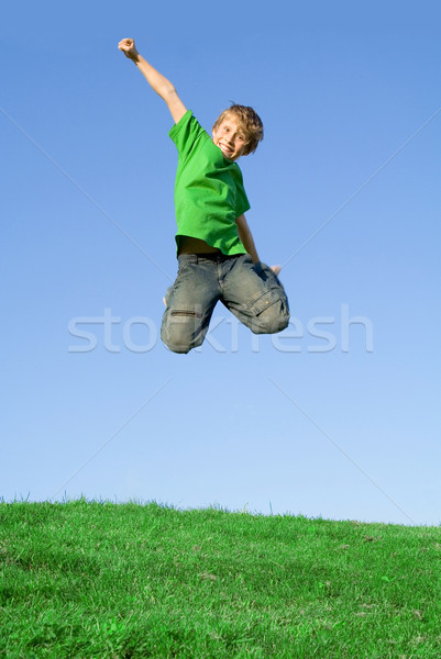 happy kid jumping outside in summer Stock photo © godfer