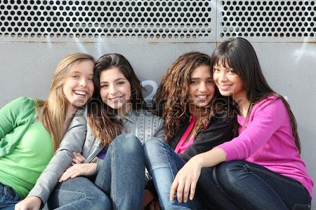 mixed race group of smiling girls Stock photo © godfer