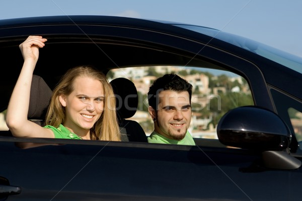 couple on road trip in new or hire rental car Stock photo © godfer