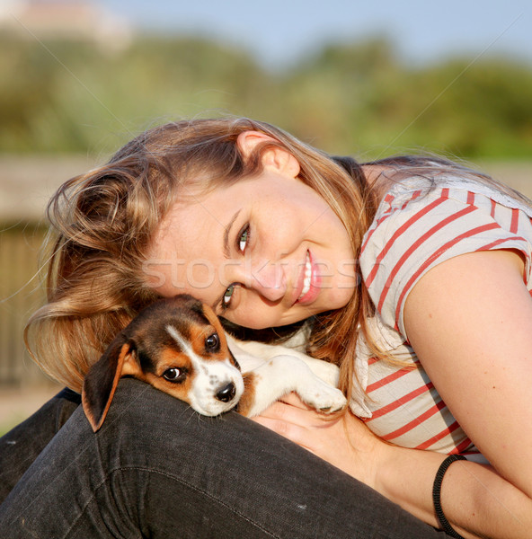 Stock photo: happy teen young woman with her pet puppy dog