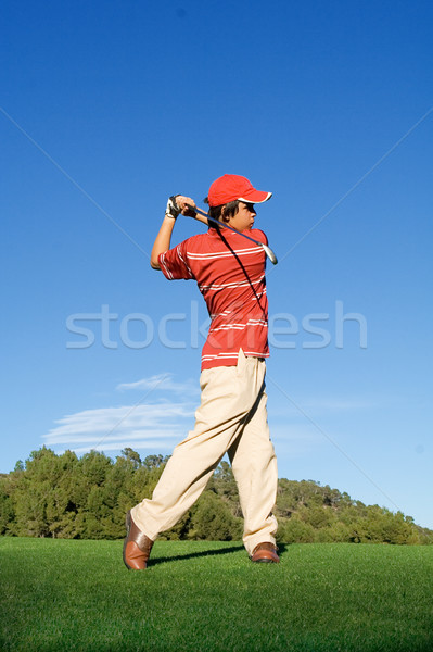 young, man swinging golf club  Stock photo © godfer