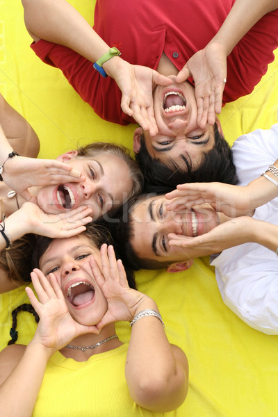 group of happy teens shouting or singing Stock photo © godfer