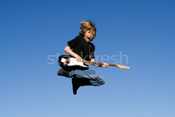 child rock guitar player and singer Stock photo © godfer