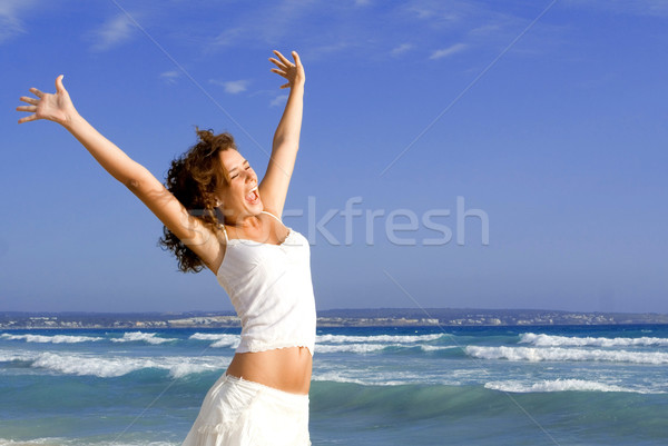 happy girl arms raised on beach holiday vacation Stock photo © godfer