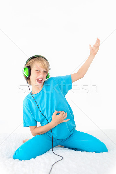 young teen kid playing air guitar Stock photo © godfer