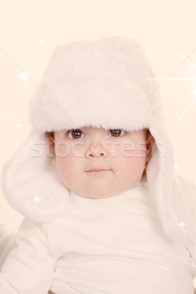 cute baby in furry hat Stock photo © godfer