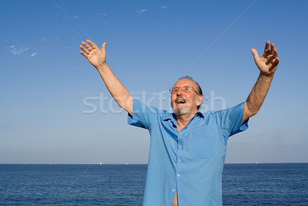happy christian senior man arms raised in faith and praise Stock photo © godfer