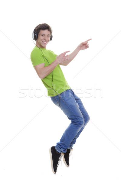 Işaret genç kulaklık müzik adam arka plan Stok fotoğraf © godfer