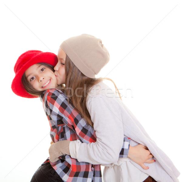 Amitié soeurs baiser amis sourire enfants Photo stock © godfer