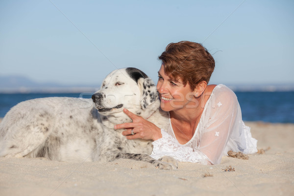 woman with old pet mongrel dog Stock photo © godfer