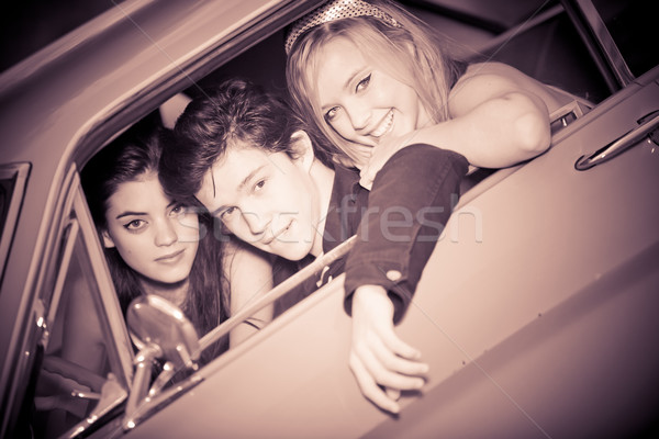 60s look image of people in car Stock photo © godfer