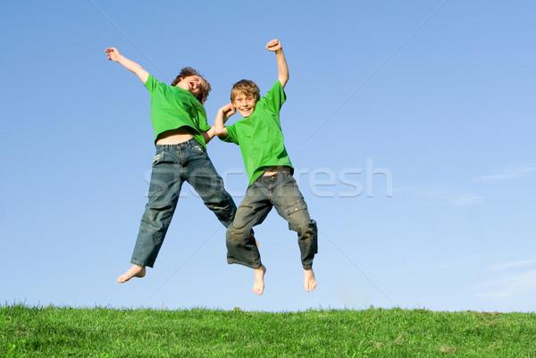 Boldog nyerő gyerekek ugrik ünneplés gyerekek Stock fotó © godfer