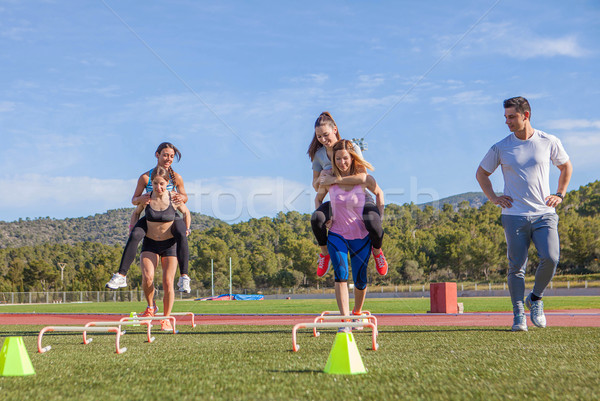 fitness class piggyback race Stock photo © godfer