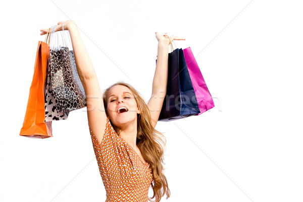 happy woman shopper with shopping bags Stock photo © godfer