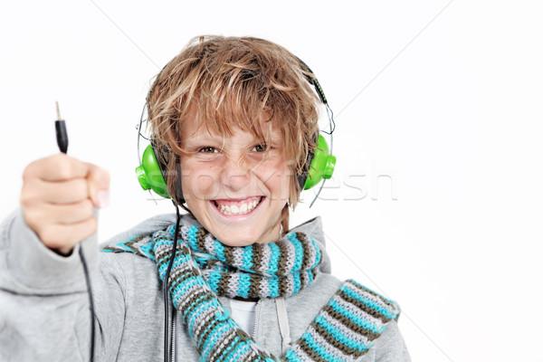 child with headphones Stock photo © godfer