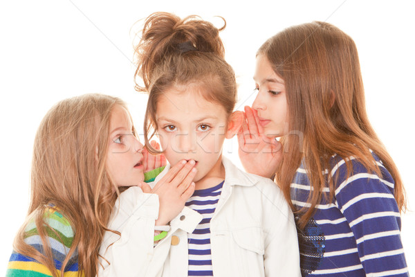 kids whispering bad news Stock photo © godfer