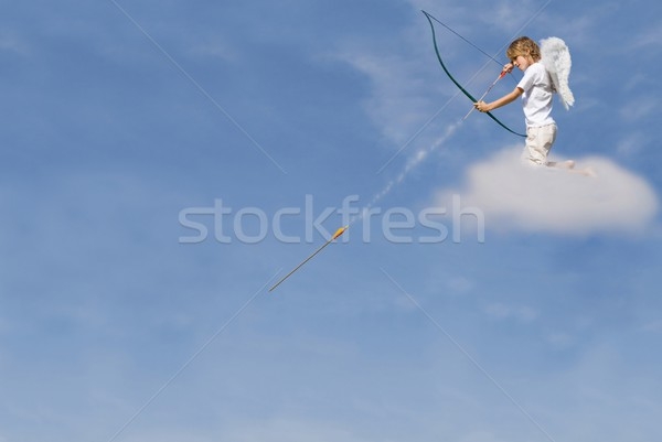 Stock photo: cupid firing arrow from cloud for valentines day