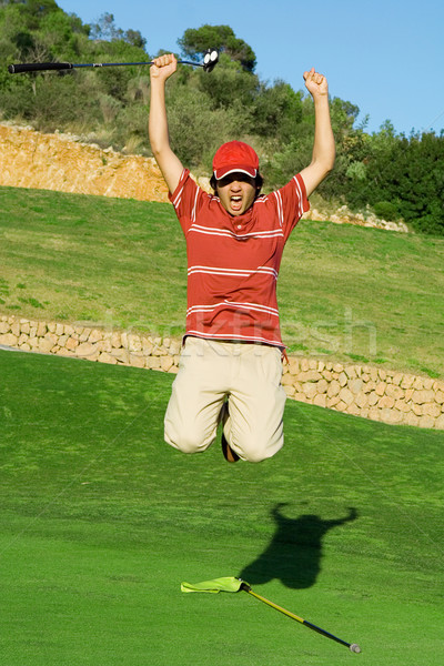 Stock photo: young golfer, cadet or junior celebrating win