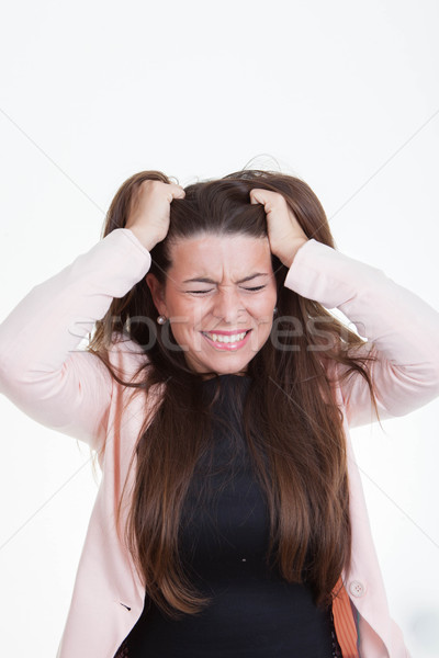 frustrated annoyed woman tearing hair out Stock photo © godfer