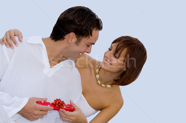 happy couple exchanging engagement wedding or birthday gift. Stock photo © godfer