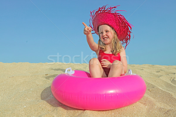 happy kid on vacations on beach pointing Stock photo © godfer