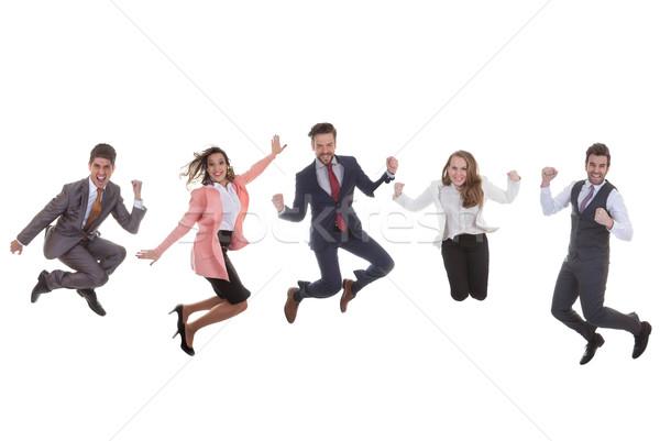 Squadra di affari gruppo jumping successo felice donne Foto d'archivio © godfer
