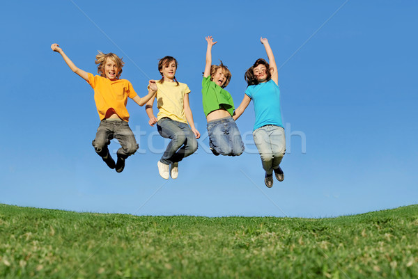 fit healthy children jumping outdoors in summer Stock photo © godfer
