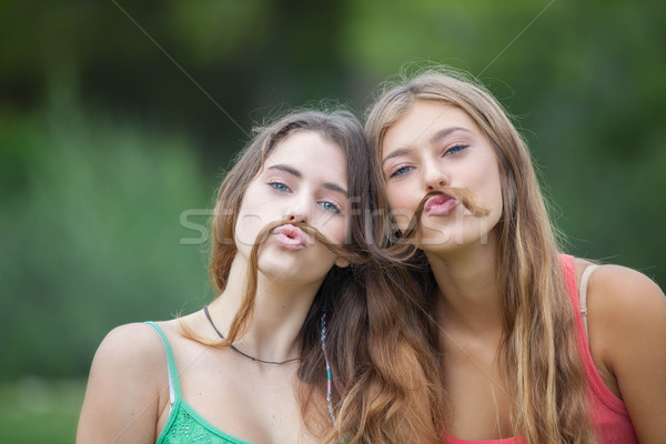 playful teens with hair moustache Stock photo © godfer