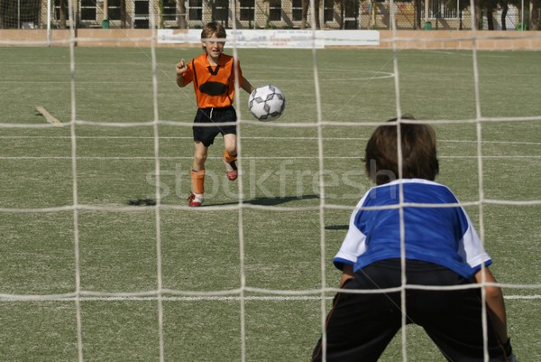 kids playing football or soccer game Stock photo © godfer
